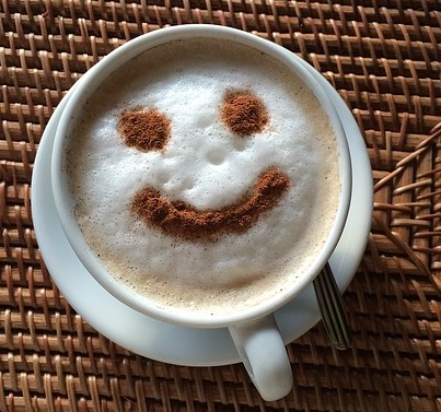 Coffee foam with smile in chocolate